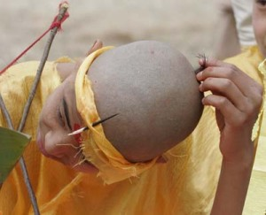 Boy after his head is shaved at the ceremony
