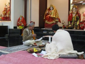 P and the priest start the Bratabandha ceremony