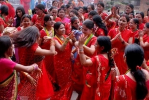 Women celebrate Teej in Kathmandu with red saris and green/yellow pote (Photo credit)