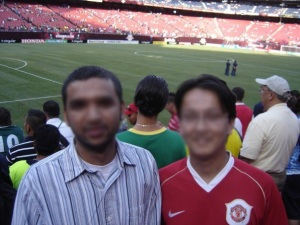 "D (""the Chelsea fan"") and P (""the Man U fan"") at a Barcelona game a few years ago"