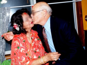 """Frank Uncle gives B Aunty a quick """"peck on the cheek"""" after giving her tikka for Dashain"""