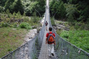 """Picture of P on a suspension bridge during our hike in the Everest region of Nepal in June. """"Frank Uncle"""" helped build the first generation of these bridges in communities throughout the mountainous region"""