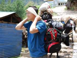 """P channels his """"inner Sherpa"""" as he tries to carry our porter's load during a tea break"""