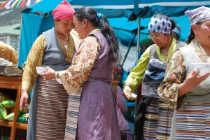 Sherpa women (Sherpani) serve us local food during the festival